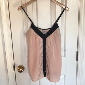 Light pink tank with black trim and gold buttons